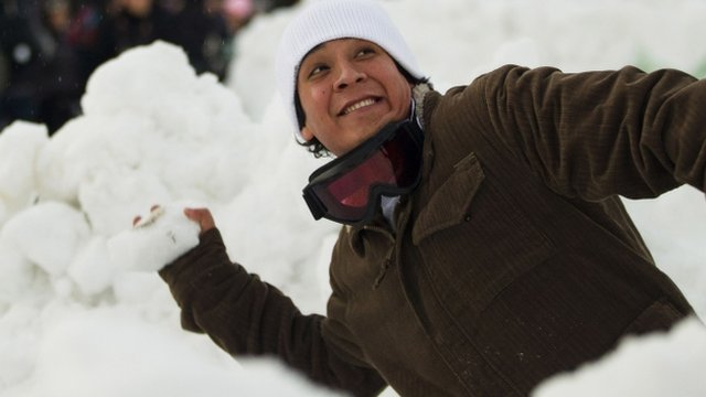 An attendee prepares to hurl a snowball