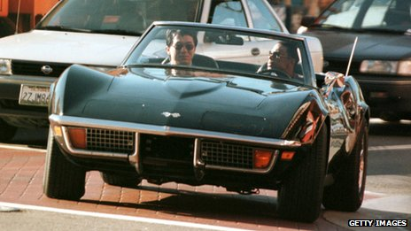 Actors Jackie Chan and Chris Tucker in a Corvette during filming