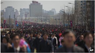 People walk at a military parade in Pyongyang, North Korea (April 2012)