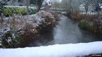 Letcombe Brook in Grove, Oxfordshire flowing through the snow