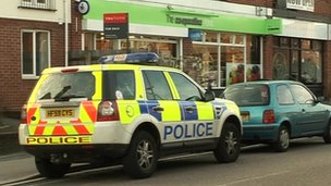 A police vehicle outside the Co-op supermarket store on Cranleigh Road in Southbourne