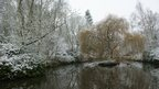Snow on pond at Normanby Hall
