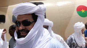 Ansar Dine leader Iyad Ag Ghaly waits for the Burkinabe foreign minister at Kidal airport on 7 August 2012