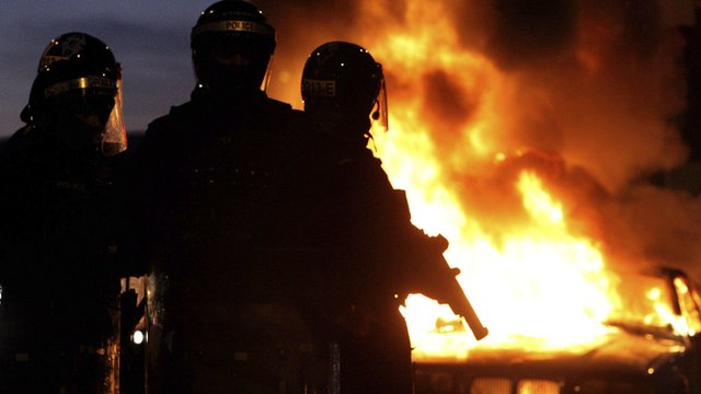 PSNI officers and burning car