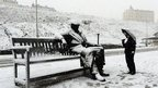 Snow on the Freddie Gilroy and the Belsen Stragglers sculpture by Ray Lonsdale in Scarborough