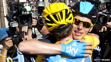 Chris Froome (right) is thanked by Bradley Wiggins for his support in the Tour de France