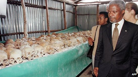 Kofi Annan walks past skulls at a memorial site on 8 May 1998.