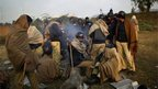 Pakistani police gather round a fire in Islamabad, 15 January 2013