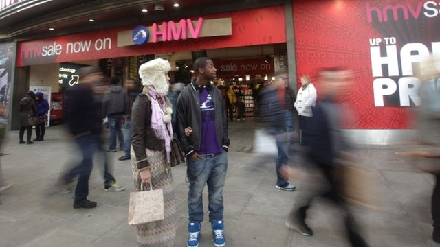 Shoppers outside HMV