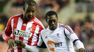 Sunderland&#039;s Titus Bramble (left) and Bolton&#039;s Marvin Sordell
