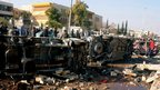 Overturned cars on the University of Aleppo&#039;s campus (15 January 2013)