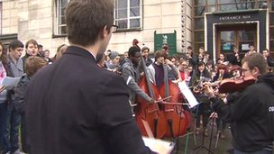 Young musicians in concert outside Newport council offices
