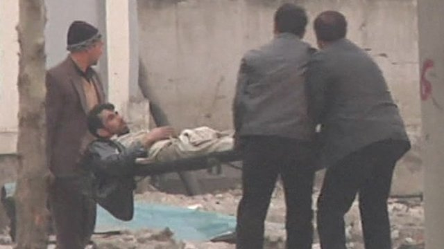 Wounded in Kabul being stretchered off