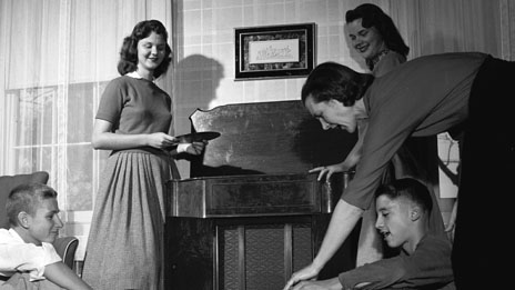 A family listening to records in the 1950s