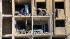 Destroyed facade of dormitories at the scene of a explosion outside Syria's Aleppo University