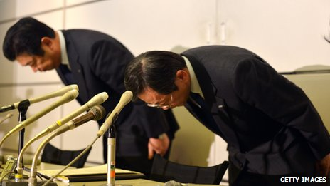 All Nippon Airways executive Hiroyuki Ito (left) nd vice-president Osamu Shinobe bow their heads