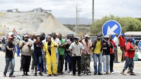 A group of miners gather outside an Anglo American Platinum shaft in Rustenberg