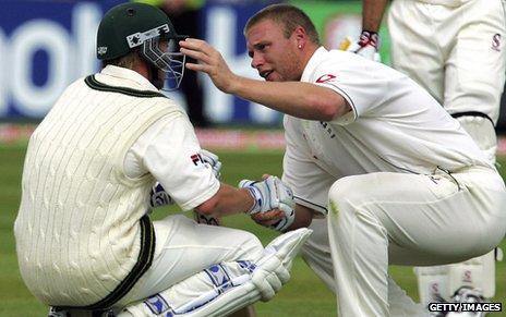 England's Andrew Flintoff consoles Australia's Brett Lee