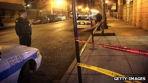 Police cord across a street where a shooting has occurred in Chicago, Illinois 8 January 2013