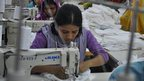 Women operating sewing machines in a factory in Bangladesh