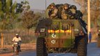 French army soldiers stand on armoured vehicles as they leave Bamako and start their deployment to the north of Mali as part of Operation Serval (15 Jan 2013)