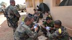 French troops play cards at the 101 military airbase near the capital of Mali, Bamako (15 Jan 2013)