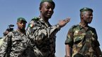 Mali's army chief of staff, Gen Ibrahima Dahirou Dembele (c) arrives for a meeting of Ecowas chiefs of staff at the Mali peacekeeping training centre in Bamako (16 Jan 2013)