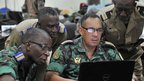 An Ivorian officer (r) and other ECOWAS army officers prepare a document during a meeting of chiefs of staff at the Mali peacekeeping training centre in Bamako (16 Jan 2013)