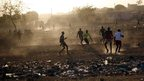 Young men play football in Bamako, Mali, on Tuesday (15 Jan 2013)