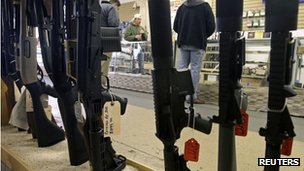 Customers shop at the Guns-R-Us gun shop in Phoenix, Arizona, 20 December 2012