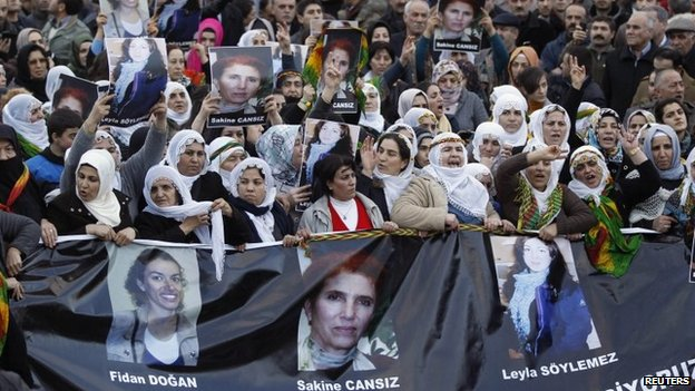 Protesters mourn the bodies of PKK activists arriving at Istanbul airport