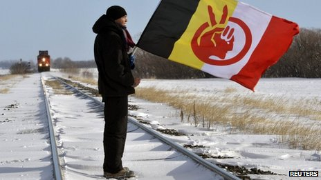 Demonstrator Black Cloud blocks the Canadian National Railway line just west of Portage la Prairie, Manitoba 16 January 2013