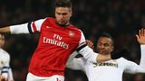 Olivier Giroud of Arsenal is tackled by Kyle Bartley of Swansea City
