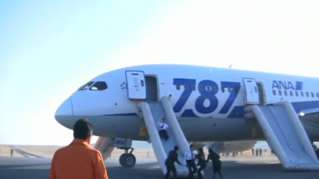 Passengers evacuating a Dreamliner aircraft in Japan