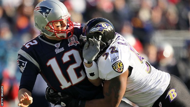 Ray Lewis (right) tackles Tom Brady during a 2010 clash between the Baltimore Ravens and the New England Patriots