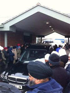 Mourners at funeral of Tarsem King