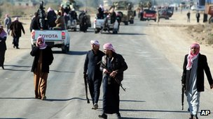 Bodyguards protect the funeral cortege of Sunni MP Eifan Saadoun al-Issawi in Fallujah on Wednesday
