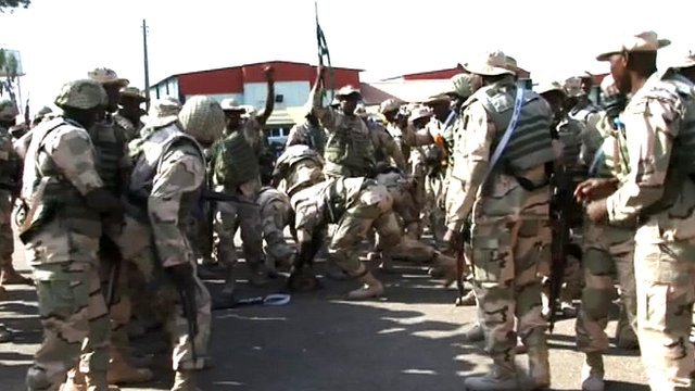 Nigerian soldiers prepare to go into northern Mali