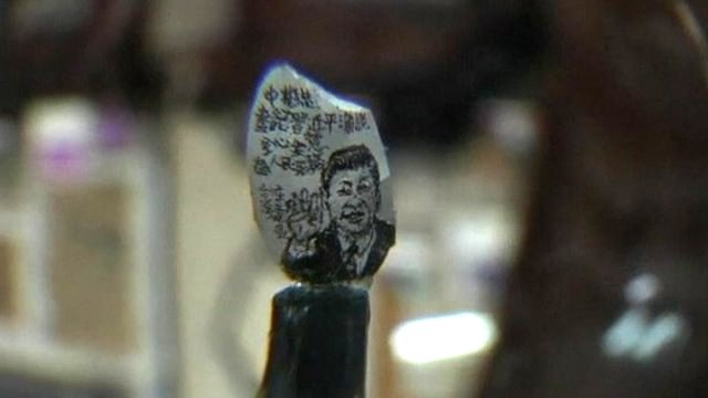 Portrait of Xi Jinping on a grain of rice
