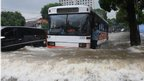 A bus battles through a flooded street in Jakarta, Indonesia, on 17 January 2013
