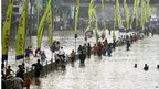 Indonesians wade through floodwaters in Jakarta, Indonesia, on 16 January 2013
