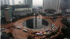 Indonesians wade through floods in a central roundabout in Jakarta, Indonesia, on 17 January 2013