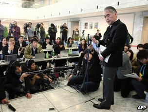 Takeshi Endo, public relations manager of Japanese plant construction company JGC is surrounded by press at company HQ in Yokohama, suburban Tokyo, 17 January