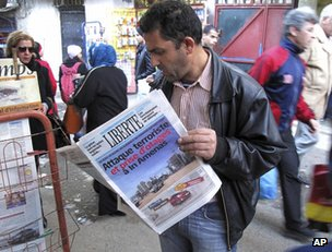 Man reads newspaper in Algiers, 17 January