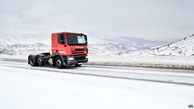 Lorry drives through snow covered Brecon Beacons