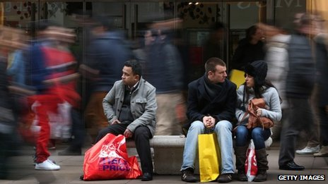 Shoppers rest on a busy Oxford Street in London during the Boxing Day sales
