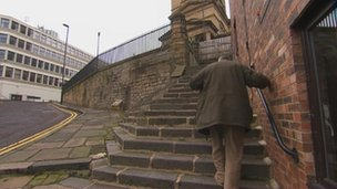 Mark Holdstock on steps by home