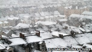 Snow covers the rooftops of houses in Swansea