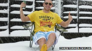 Christopher Taylor sits in the snow