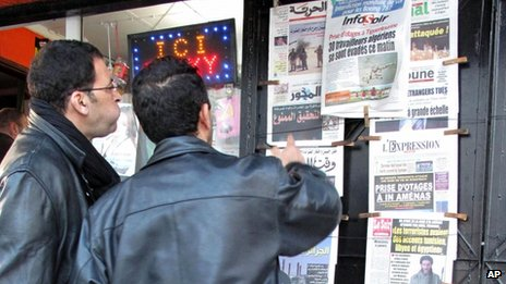 Algerian men look at national newspapers headlining the terrorist attack and kidnapping in Amenas at a news stand in Algiers, Thursday, Jan. 17, 2013.